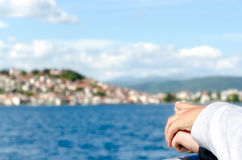 We are going there. Couple in love holding hands and pointing to their next travel destination or island Royalty Free Stock Images