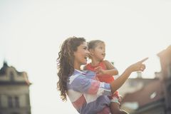 We are going there. Mother showing something her daughter on city street. Close up. Copy space royalty free stock image