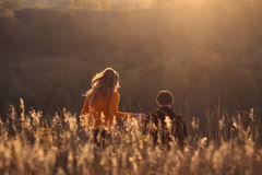 Young happy beautiful couple has romantic date on hills outdoors Stock Photo