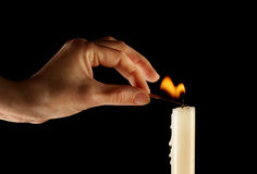 Going to burn a candle Stock Images