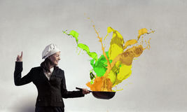 She is going to cook her idea . Mixed media Royalty Free Stock Photography