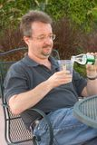 Going to drink. Man poring water into glass Stock Photo