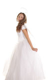 Going to fly. Pretty curled girl in angel dress in going to fly pose isolated Royalty Free Stock Photo