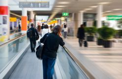 Going to the gate. Man on escalator is going to his gate royalty free stock photography