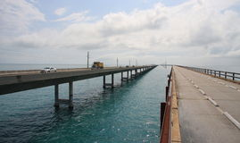 Going to Key West: the seven mile bridge. The picture shows the new and the old seven mile bridge. Peering over the rusting guardrails you gaze into the Stock Photography