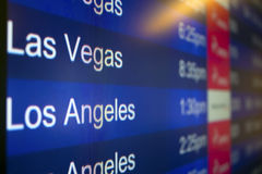 Going to Las Vegas or Los Angeles. Departures or arrivals signs for Las Vegas and Los Angeles at an airport stock photos