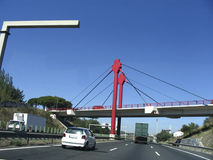 Going to Lisbon. On the road, up to Lisbon, Portugal, a red bridge over the road, cars and trucks Stock Images
