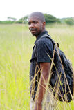 Going to the nature. An african backpacker is about to start his wild nature journey Stock Images