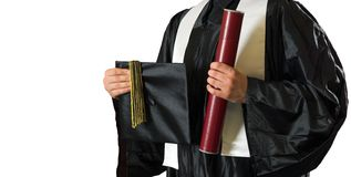 Going to the real world. Graduate student holding a diploma and a mortarboard Stock Photography