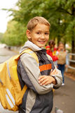 Going to school. Portrait of happy lad with rucksack on back looking at camera Royalty Free Stock Photo