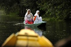 Going to school. Children going to school by boat on Dal Lake in Srinagar, capital of Kashmir Royalty Free Stock Images