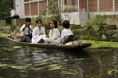 Going to school. Children going to school by boat on Dal Lake in Srinagar, capital of Kashmir Stock Photography