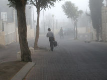 Going to school. Ultra ortodox kid,going to school on a fogy morning stock image