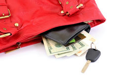 Going to shopping. Money, credit card and car key in te Red bag. Woman ready for shopping. Isolated on white stock photo
