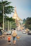 Going to Shwedagon pagoda. Tourists are going to Shwedagon pagoda in Yangon. Myanmar Royalty Free Stock Image