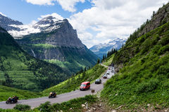 Going-to-the-Sun road in Glacier National Park, USA. Glacier National Park, USA - July 4, 2016: Cars driving the crowded Going-to-the-Sun road on the 4th of July Royalty Free Stock Photos