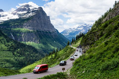 Going-to-the-Sun road in Glacier National Park, USA. Glacier National Park, USA - July 4, 2016: Cars driving the crowded Going-to-the-Sun road on the 4th of July Royalty Free Stock Images