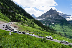 Going-to-the-Sun road in Glacier National Park, USA. Glacier National Park, USA - July 4, 2016: Crowded Weeping Wall parking lot on 4th of July national holiday Royalty Free Stock Photo