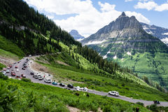 Going-to-the-Sun road in Glacier National Park, USA. Glacier National Park, USA - July 4, 2016: Crowded Weeping Wall parking lot on 4th of July national holiday Royalty Free Stock Photos