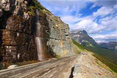 Going To The Sun Road - Montana. Waterfall flowing onto the Going To The Sun Road - Montana Royalty Free Stock Photos