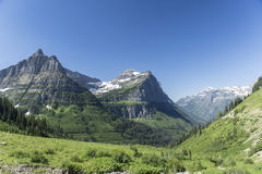 Going-to-the-sun Road Overlook. An overlook showing snow covered mountains on Going-to-the-sun road in Glacier National Park, Montana, United States Stock Photography