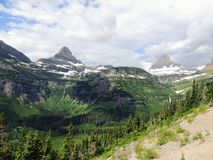 Going to the Sun Road, View of Landscape, snow fields In Glacier National Park around Logan Pass, Hidden Lake, Highline Trail, whi. Ch features waterfalls Royalty Free Stock Image