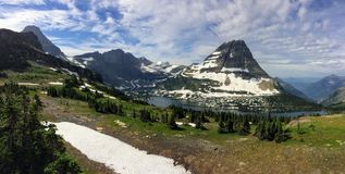 Going to the Sun Road, View of Landscape, snow fields In Glacier National Park around Logan Pass, Hidden Lake, Highline Trail, whi. Ch features waterfalls Royalty Free Stock Images