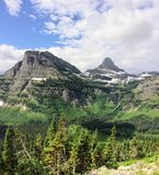 Going to the Sun Road, View of Landscape, snow fields In Glacier National Park around Logan Pass, Hidden Lake, Highline Trail, whi. Ch features waterfalls stock image