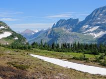 Going to the Sun Road, View of Landscape, snow fields In Glacier National Park around Logan Pass, Hidden Lake, Highline Trail, whi Stock Photo