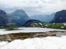 Going to the Sun Road, View of Landscape, snow fields In Glacier National Park around Logan Pass, Hidden Lake, Highline Trail, whi. Ch features waterfalls Stock Photo