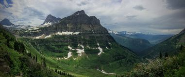 Going to the Sun Road, View of Landscape, snow fields In Glacier National Park around Logan Pass, Hidden Lake, Highline Trail, whi. Ch features waterfalls Stock Photography
