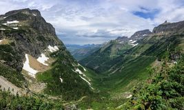 Free Going To The Sun Road, View Of Landscape, Snow Fields In Glacier National Park Around Logan Pass, Hidden Lake, Highline Trail, Whi Royalty Free Stock Photo - 99589995
