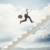 Going to the top. Businessman go up on abstract 3d stair Royalty Free Stock Photography