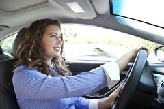 Going to Work. Woman driving a car on the highway Royalty Free Stock Photography