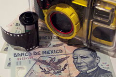 Going on a Trip. Photo of Mexican money, underwater camera and film Stock Photos