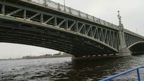 Going from underneath the Trinity Bridge, St Petersburg, Russia. City landscape, the Peter and Paul Fortress, slow mo. Sightseeing. Going from underneath the stock footage