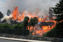 Going up 1. A thatched roof house on fire. Jan 22 2008. Hermanus South Africa Royalty Free Stock Images
