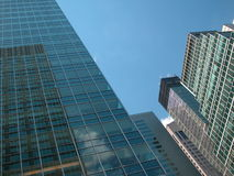 Going Up. Buildings in Midtown Manhattan with reflection of sky and surrounding buildings Stock Photography