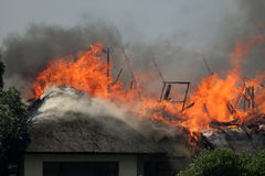 Going up 3. A thatched roof house on fire. Jan 22 2008. Hermanus South Africa Stock Images