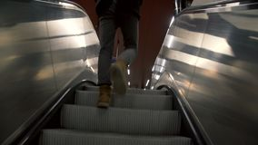 Going up by escalator to the train platform. Man going up by escalator to the train platform stock video footage