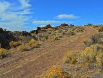 Going Up the Ridge. Road up the ridge to the top of Jasper Rocks - Crooked River National Grassland - near Culver, OR Royalty Free Stock Photo