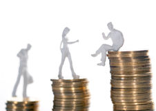 Going up on the social position. Concept of three persons in different positions on piles of coins Stock Images