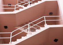 a pink apartment building staircase in southern Fl Stock Images