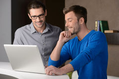We are going up.Two cheerful businessmen dicussing something on stock images