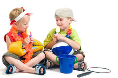 Going On Vacation. Two boys ready to go on vacation, enjoying their first icecream Royalty Free Stock Image