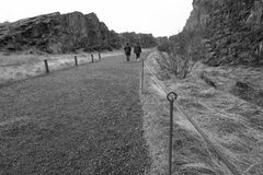 Going for a walker. Two ladys walk on paveway in the mountain,Iceland Stock Photography