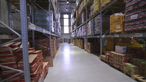 Going through warehouse. Distribution Warehouse With Shelves From Moving Forklift Truck