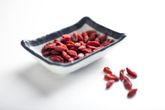 Goji Berries. On plate. Shallow focus Royalty Free Stock Photo