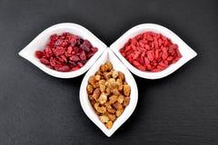 Goji berries,cranberries, white mulberries. Royalty Free Stock Photos