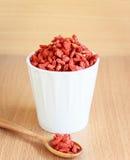 Goji berries. Cup of goji berries on wood background Royalty Free Stock Photo